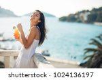 carefree young female on... | Shutterstock . vector #1024136197
