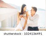 attractive couple drinking... | Shutterstock . vector #1024136491