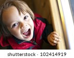 Cute Child with toothy smile with available light - stock photo