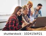 young volunteers help senior... | Shutterstock . vector #1024156921
