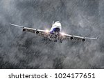 Large passenger airplane approaches the landing at the airport of rain, bad weather - stock photo