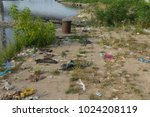 waste in the river  and on the... | Shutterstock . vector #1024208119