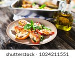stuffed peppers with  sardines... | Shutterstock . vector #1024211551