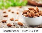 almonds in white porcelain bowl ... | Shutterstock . vector #1024212145