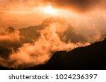 fog drifted massively floating... | Shutterstock . vector #1024236397
