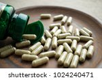 close up green capsules ginkgo... | Shutterstock . vector #1024240471