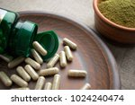close up green capsules  bottle ... | Shutterstock . vector #1024240474