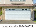 garage door in vancouver ... | Shutterstock . vector #1024240594