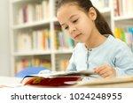 pretty little girl reading a... | Shutterstock . vector #1024248955