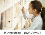 profile shot of a pretty little ... | Shutterstock . vector #1024249474