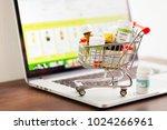 mini shopping cart full of... | Shutterstock . vector #1024266961