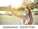 selfie on vacation  | Shutterstock . vector #1024277164