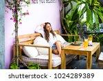 a beautiful woman xhas... | Shutterstock . vector #1024289389