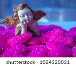 A Cute Plaster Doll Of Cupid...