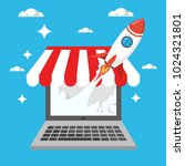 rocket launch from laptop... | Shutterstock .eps vector #1024321801