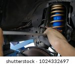 maintaining a car shock...   Shutterstock . vector #1024332697