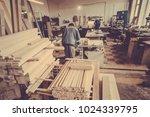 a carpenter works on... | Shutterstock . vector #1024339795