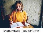 dreamy young woman writing down ... | Shutterstock . vector #1024340245