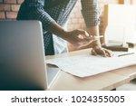 man standing typing on... | Shutterstock . vector #1024355005