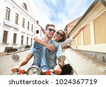happy young couple riding... | Shutterstock . vector #1024367719