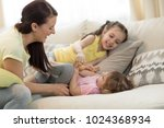 smiling kids and their mom... | Shutterstock . vector #1024368934