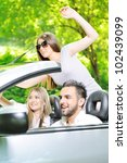 three friends in a sports car | Shutterstock . vector #102439099