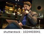 happy businessman drinking... | Shutterstock . vector #1024403041