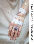 patient's hand with drip... | Shutterstock . vector #1024414951