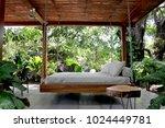 swinging outdoor bed | Shutterstock . vector #1024449781
