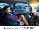 sleeping driver in autonomous... | Shutterstock . vector #1024451881