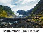 hiker walks on the valley... | Shutterstock . vector #1024454005