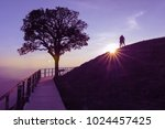 couple silhouette on hill and... | Shutterstock . vector #1024457425