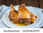 tender roast suckling pig heads ... | Shutterstock . vector #1024463599