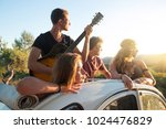 group of happy people in a car... | Shutterstock . vector #1024476829