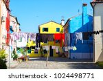 colourfully painted house... | Shutterstock . vector #1024498771