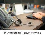 close up on headset of call... | Shutterstock . vector #1024499461
