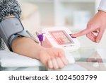 doctor cardiologist measuring... | Shutterstock . vector #1024503799