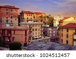 City landscape at sunset of the day in the Italian city of La Spezia. Traditional architecture of Italy. Brick residential buildings of citizens. - stock photo