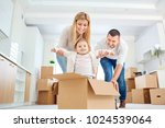 a happy family moves to a new... | Shutterstock . vector #1024539064