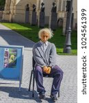Small photo of ALBA IULIA, ROMANIA - 15 MAY 2013 - The wax figure of Albert Einstein siting on a chair outside