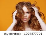 happy redheaded young woman... | Shutterstock . vector #1024577701