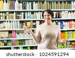 adult brunette selecting the... | Shutterstock . vector #1024591294