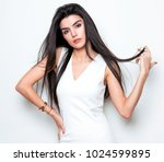 beautiful young woman with long ... | Shutterstock . vector #1024599895