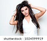 beautiful young woman with long ... | Shutterstock . vector #1024599919