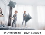kids playing in parents bed.... | Shutterstock . vector #1024625095