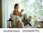 young woman sitting home in a... | Shutterstock . vector #1024634791