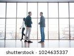 two businessmen deep in... | Shutterstock . vector #1024635337