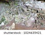 more than 100 wooden coffins ... | Shutterstock . vector #1024635421