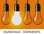 light bulbs on orange background | Shutterstock . vector #1024665691