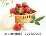 ripe juicy strawberries with whipped cream and mint - stock photo